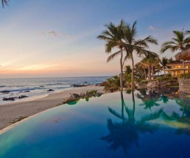 Single-Level Beachfront Sanctuary with Infinity Pool, Jacuzzi, and a Stunning Spanish Design