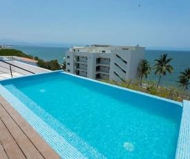 1 minute walk to the beach! Pool overlooking ocean. Condo Parotas