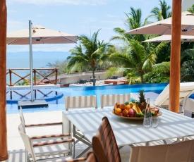 Hear the waves kiss the shoreline! Stunning beach house in five-star beachfront resort